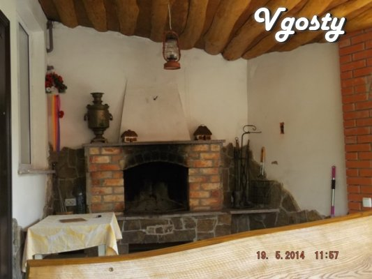 A small house with a fireplace on the terrace on the street. Trinity - Apartments for daily rent from owners - Vgosty
