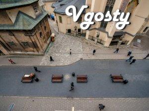Комфортні апартаменти біля Площі Ринок - Квартири подобово без посередників - Vgosty